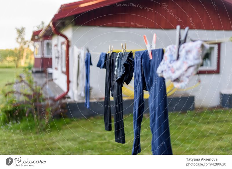 Drying clothes on rope at country backyard laundry clean clothespin summer wash air outdoor textile home eco outside building housework grass fresh green hang