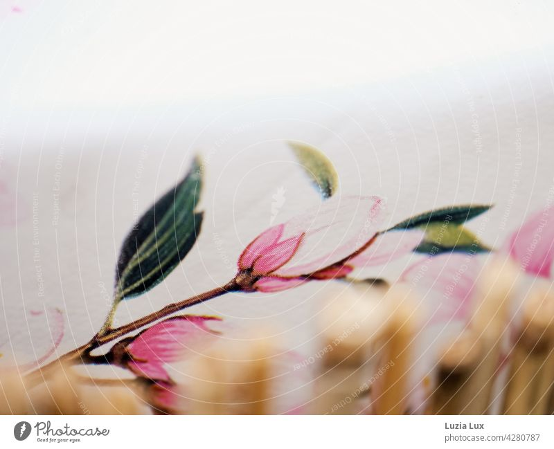 Pink flower on wax table cloth, japanese looking Blossom flowering twig Delicate pretty Bright wax tablecloth Bamboo stick Drawing Spring