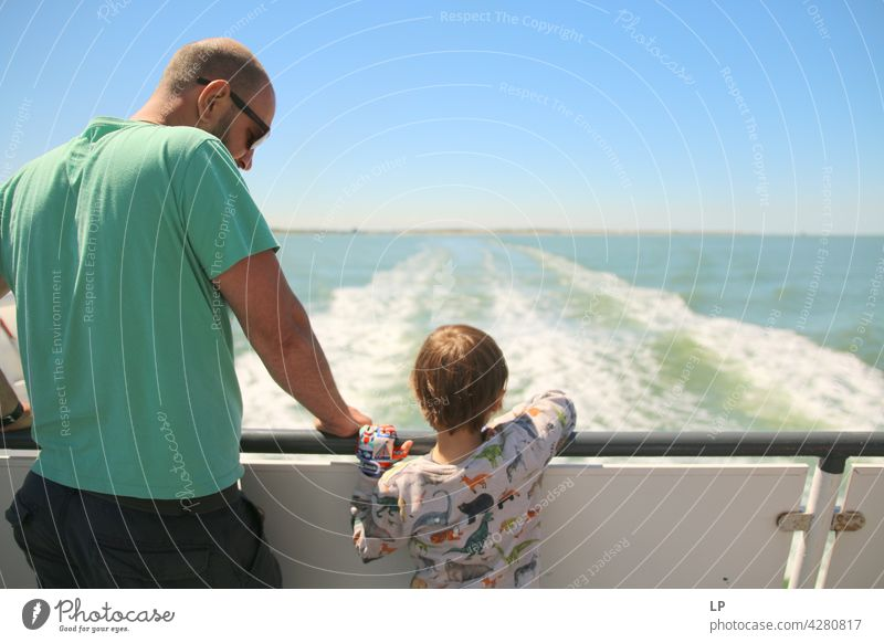 father and child looking at the water from a boat Adventurer Infancy Child portrait fortunate Happy contented Contentment Father Son Watercraft Impressive