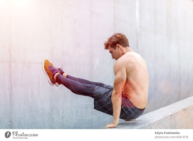 Young man exercising outdoors Jogger runner jogging running people young male energy exercise clothing fitness recreation sport healthy lifestyle action