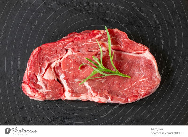 raw steak on black slate Steak uncooked Meat Raw slate plate Protein Sirloin Red Beef Cut background Eating Dinner dry age ingredient White Butcher segregated