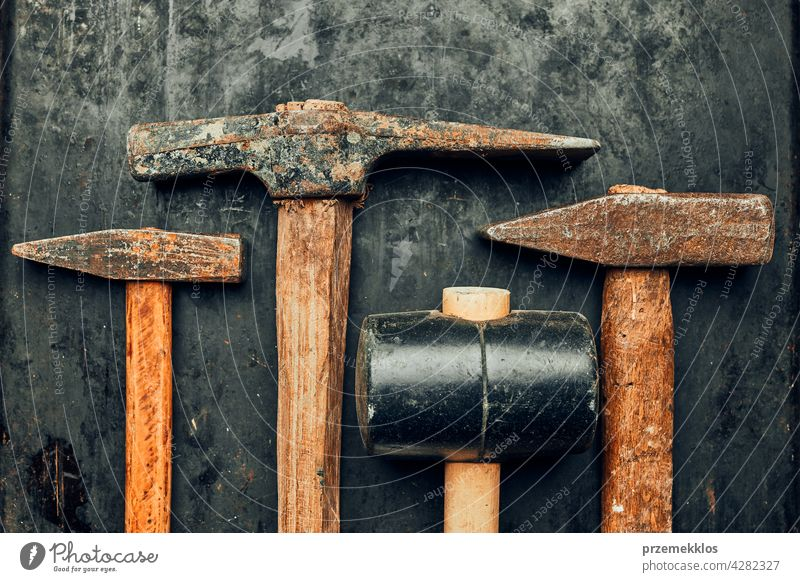 Old hammers on steel surface. Rusty tools for maintenance. Hardware tools to fix. Technical background with copy space metal hardware iron old used heavy useful