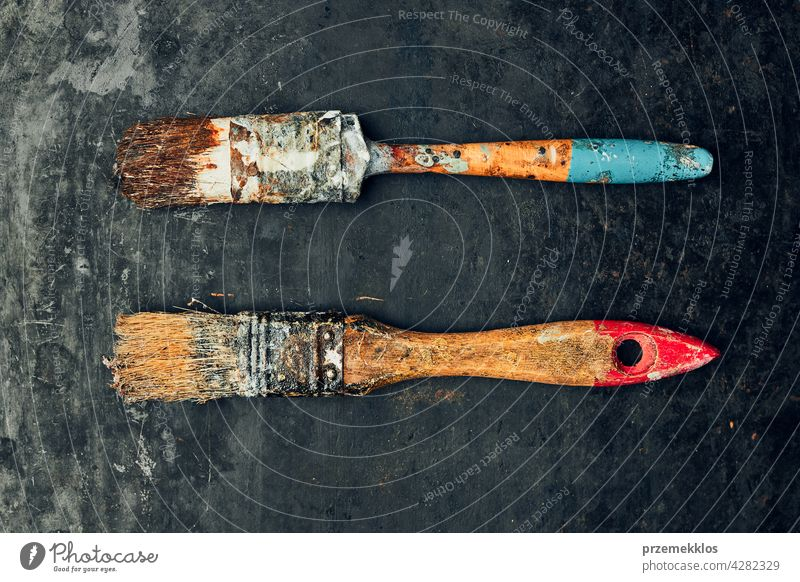 Paintbrushes on metal surface. Old brush set for house maintenance. Technical background hardware tool steel old used heavy useful workshop improvement supply