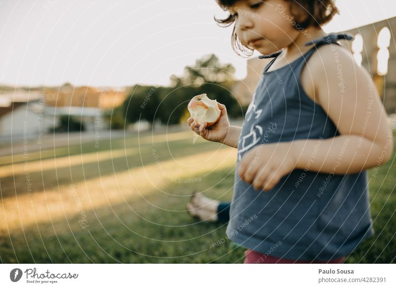 Child eating fresh fruit Girl Eating Fresh Fruit Apple Authentic 1 - 3 years Organic produce Food Healthy Human being Exterior shot Colour photo Infancy