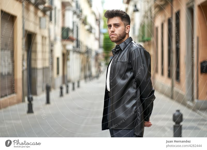 caucasian man with beard, dressed in black leather jacket young guy professional model stylish fashionable handsome shirt standing posing success cool elegant
