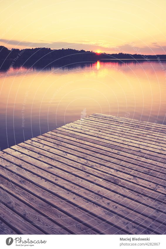 Wooden pier at golden sunset, selective focus, color toning applied, Strzelce Krajenskie, Poland. lake outdoors nature reflection calm peaceful serene scenic