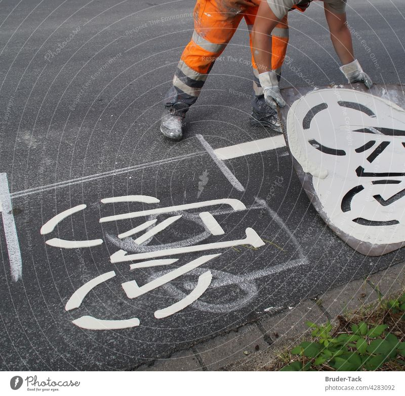 Ground marking works for a bicycle path Ground markings Road marking Lane markings Cycle path Signs and labeling Traffic lane Road traffic Asphalt