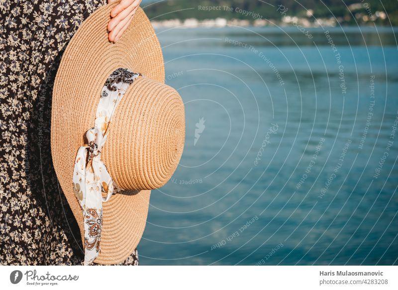 summer hat in the hand near the sea with copyspace bath beach beautiful beauty blue coast copy space fashion female girl holiday joyful leisure lifestyle nature