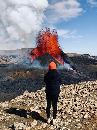 Volcanic eruption in orange Volcano Iceland Fire fountain mountain Nature Landscape Elements Exterior shot Environment Mountain Hot Deserted Climate Water Hill