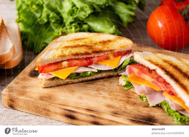 Sandwich with tomato,lettuce,ham and cheese bread breakfast club delicious fast food fresh grilled ingredient panini pressed sandwich smoked snack triangle