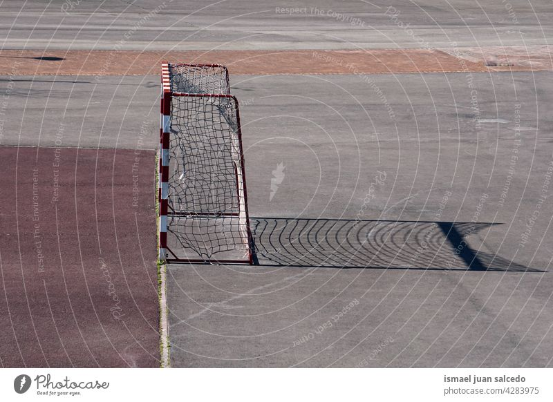 street soccer goal sports equipment net rope ground field court soccer field playing old abandoned park playground outdoors bilbao spain Sports Playing field