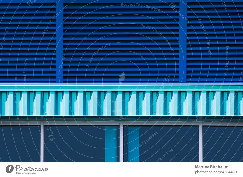 Close up of a blue bulding exterior with windows and blinds turquiose summer structure background technology abstract business architecture modern futuristic