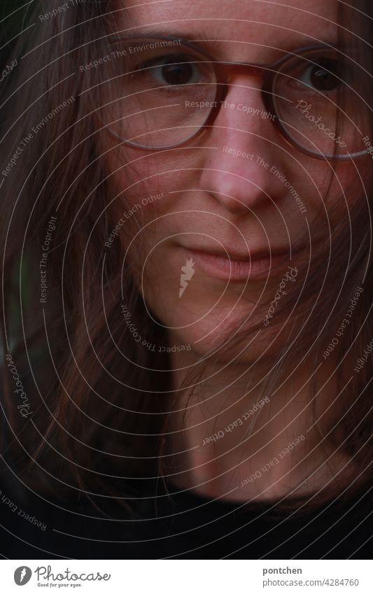 face of a middle aged woman with serious look Woman Profile Brunette gape Earnest Face hair Self-confident Demanding feminist Eyeglasses portrait