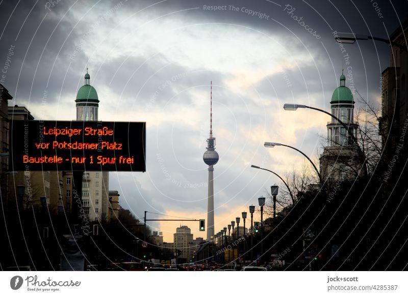 Traffic information at the Frankfurter Tor Karl-Marx-Allee Berlin TV Tower Friedrichshain Sky Clouds Street Capital city Information Transport