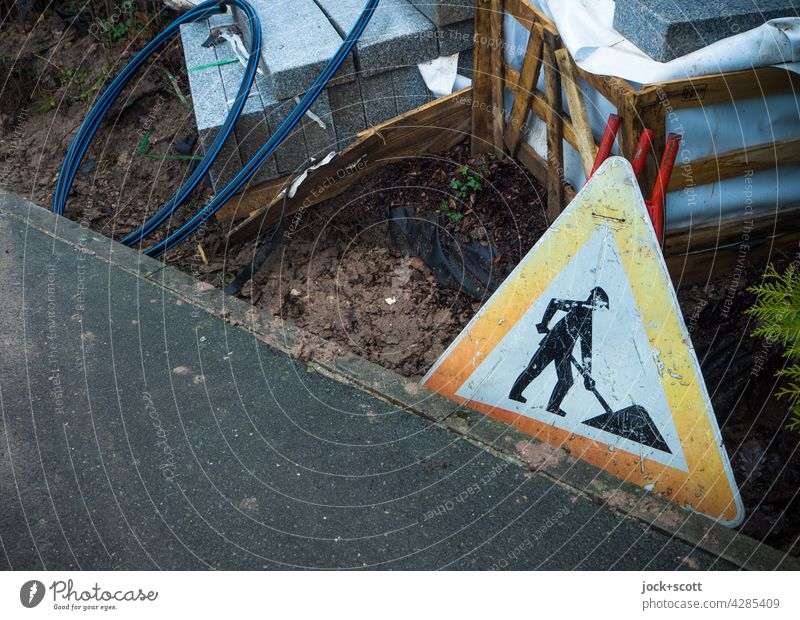 Baustelle - a road sign for Germany at the roadside Road sign StVO Triangle Signs and labeling Warning sign Safety Pictogram Caution Construction site Asphalt