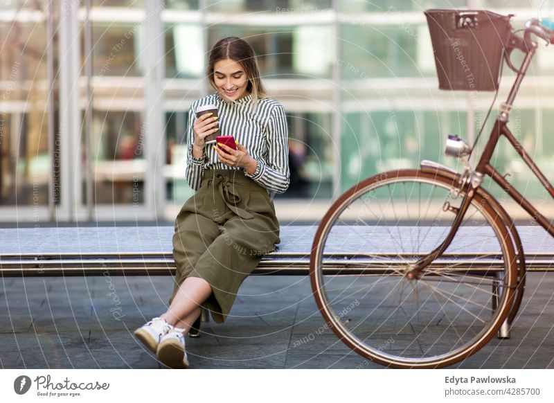 Young woman with her bicycle in the city holiday vacation fashion enjoying lifestyle young adult people casual caucasian positive happy smiling female