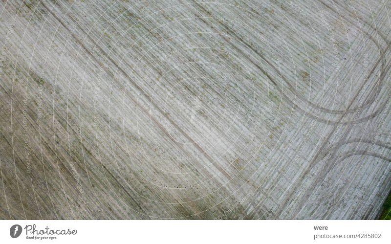 Tractor tracks on a freshly plowed field Area flight aerial view agricultural agricultural area bird's eye view copy space drone flight from above landscape