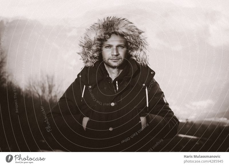 portrait of a man in black and white in jacket winter time Man Mountain Jacket Black & white photo outdoors