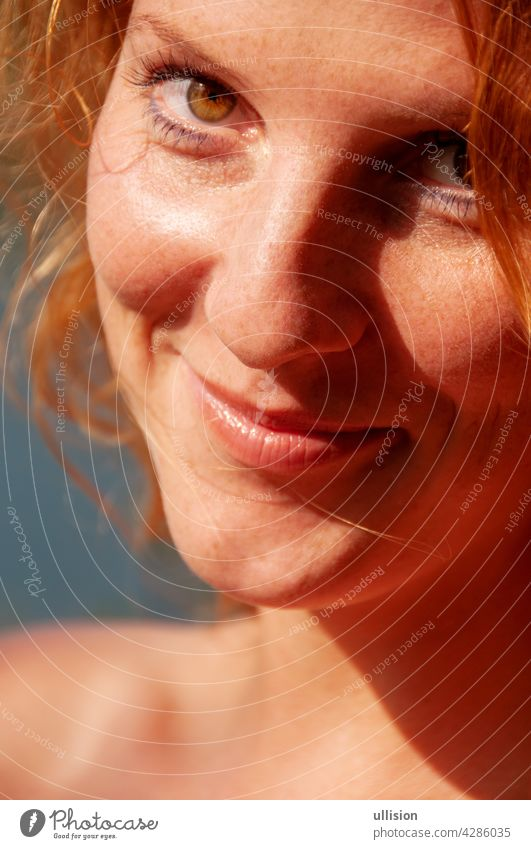 beautiful portrait of a happy redheaded woman in closeup joy carefree lifestyle sunny joyful holiday freedom happiness vacation outdoor fun casual cheerful