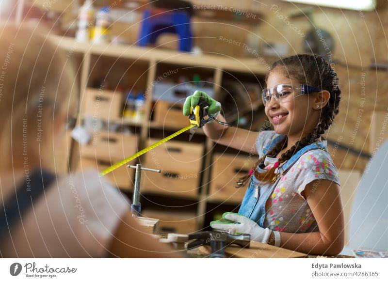 Kids working at workshop people child children kid kids girl girl power Skill craft Garage Hobby Lifestyle tools Concentration Creativity Precision Carpenter