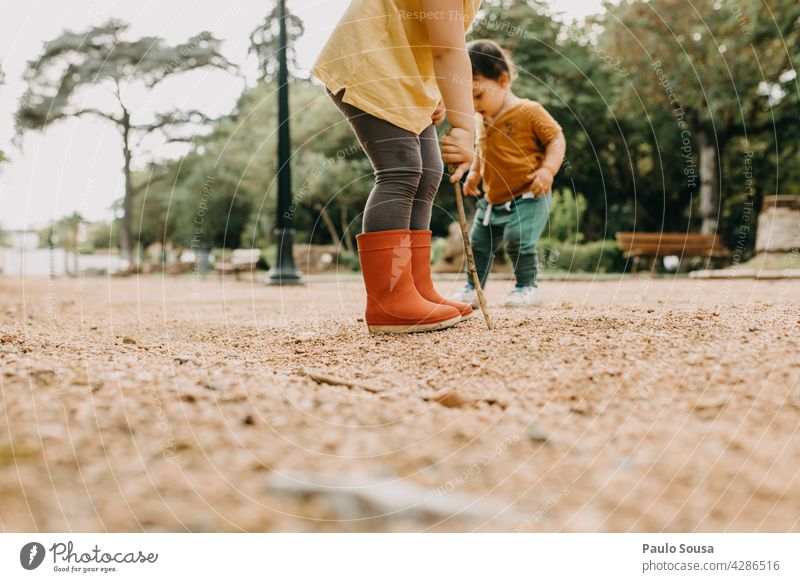 Brother and sister playing outdoors Brothers and sisters Together togetherness Playing Park Child childhood Life Human being Emotions Colour photo