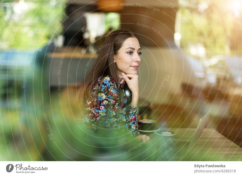 Woman with laptop in cafe people woman young adult casual attractive female smiling happy Caucasian toothy enjoying one person beautiful portrait positivity