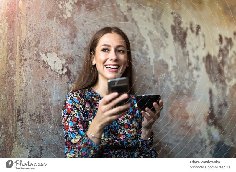 Woman with mobile phone at cafe people woman young adult casual attractive female smiling happy Caucasian toothy enjoying one person beautiful portrait
