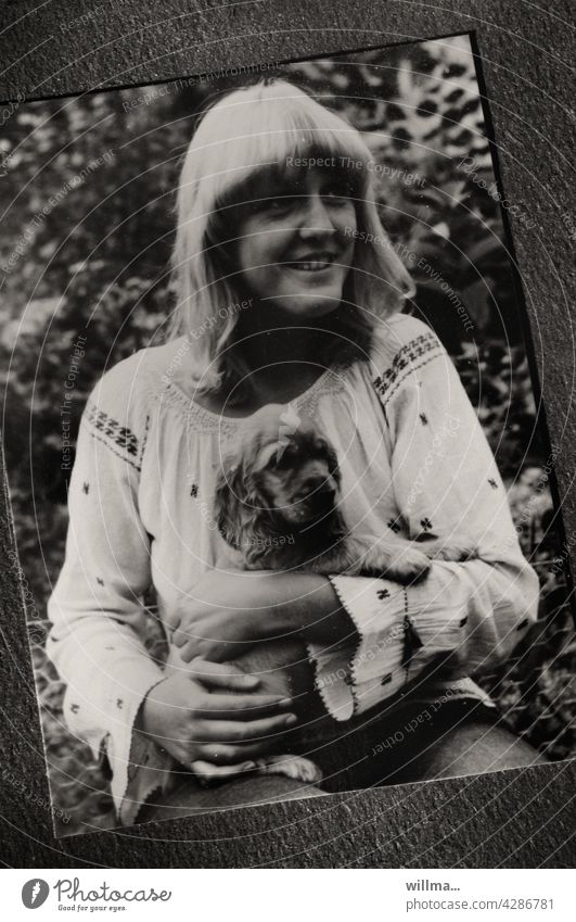 a young girl in hippie look with a little dog puppy photo Hippie look paper photo Analog Young woman Woman Dog Puppy Cocker Spaniel fringe hairstyle Bangs
