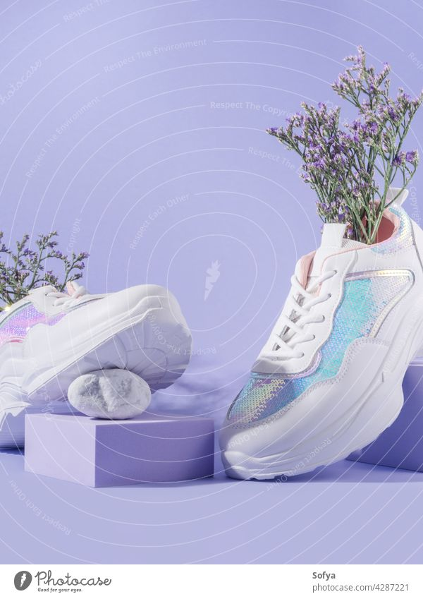 White female sneakers with sequins with flowers inside on purple background with geometric cube podium footwear shoe fashion woman walk urban nature design run
