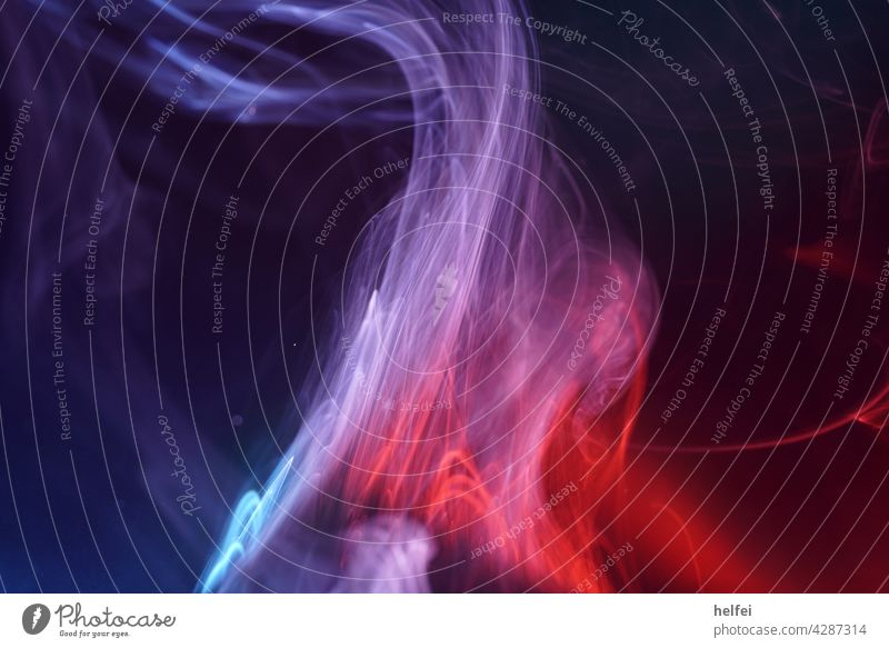 Smoke generated in the studio in front of a dark background in red and blue Fog Macro (Extreme close-up) Cigarette smoke Close-up Black Studio lighting
