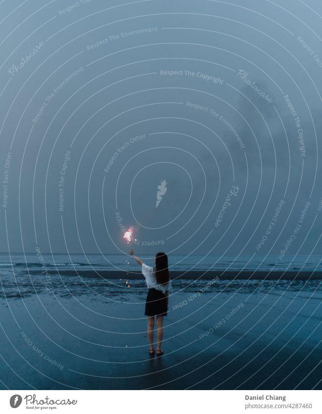 Before Sky Turn Dark Beach Blue Blue sky mood Moody fireworks night Evening Dusk Landscape lonely Woman Dress Coast Ocean To enjoy Long-haired evening light