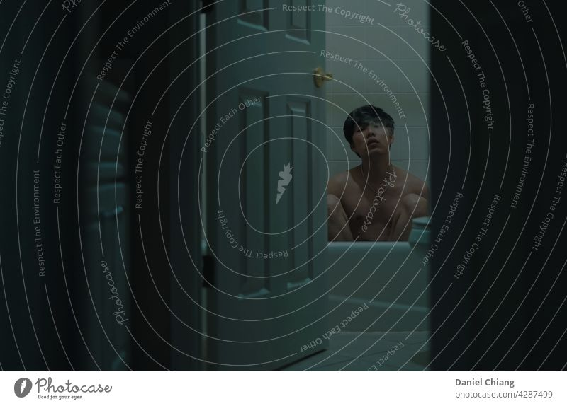 Guy Naked In The Bathroom With Smoke boy topless Dark darkness Contrast green background asian Man young Youth (Young adults) Adults Human being Hipster