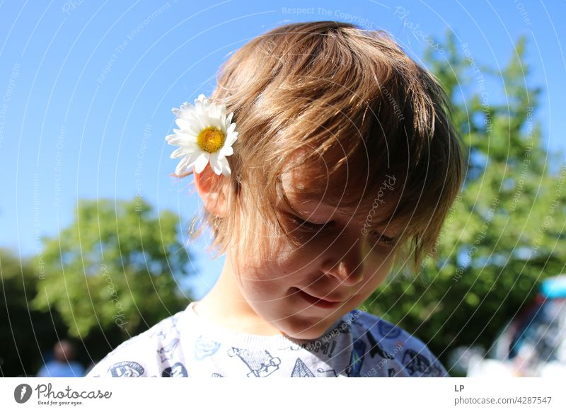 child wearing a daisy in his hair Style Design Mother's Day Human being Emotions Flower Colour photo Blossom Spring Child Parents Nature Contrast