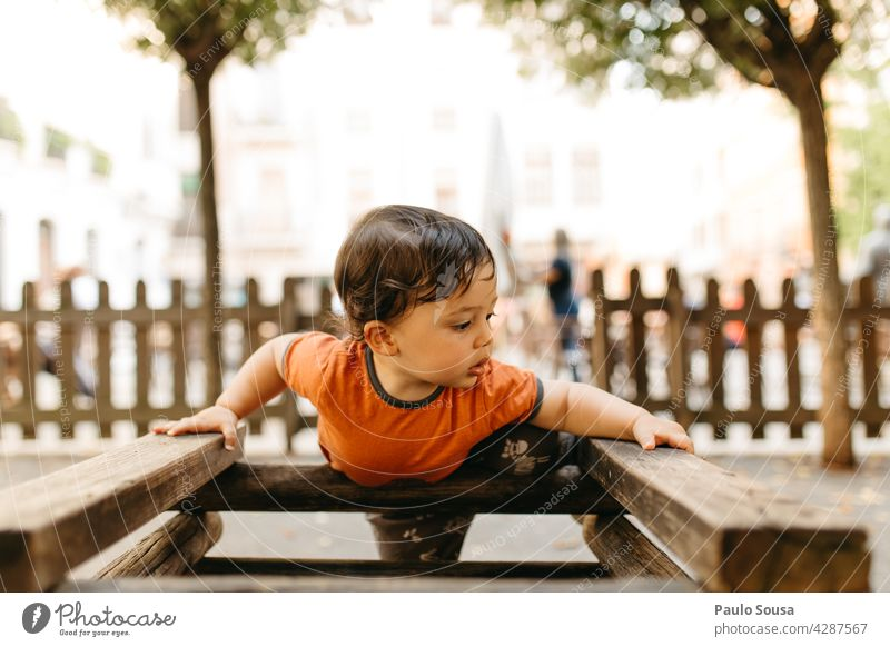 Child playing in the playground Boy (child) Caucasian 1 - 3 years Playing Playground Kindergarten Summer Infancy Toddler Colour photo Exterior shot Joy
