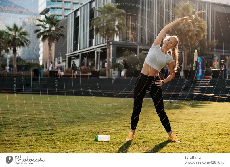 A young woman does yoga in Dubai. Sports, fitness, healthy lifestyle. Space for text dubai body girl female exercise sport asana pilates workout city relax