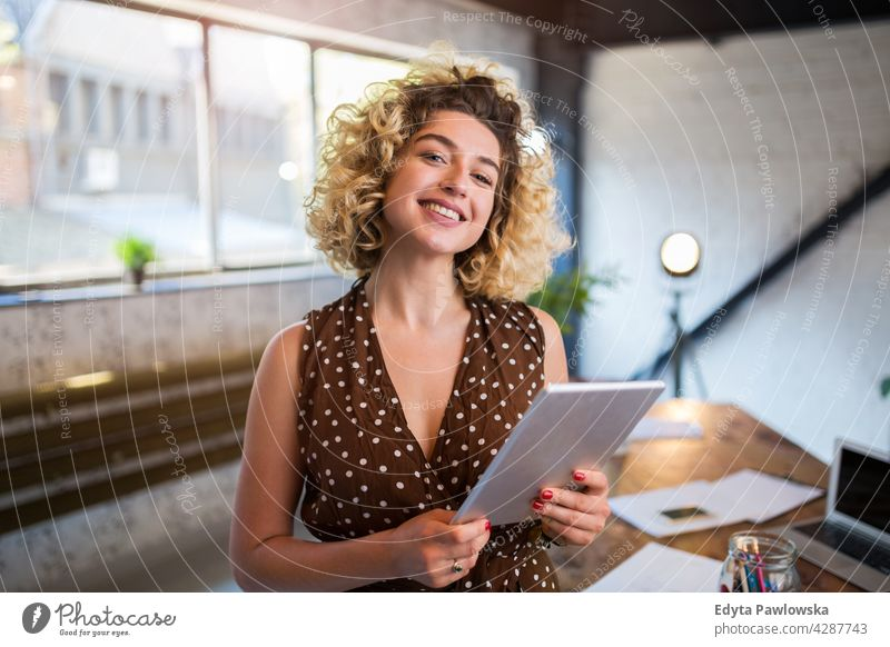 Portrait of confident creative woman in her office business businesspeople businessperson businesswoman caucasian female indoors informal casual young adult