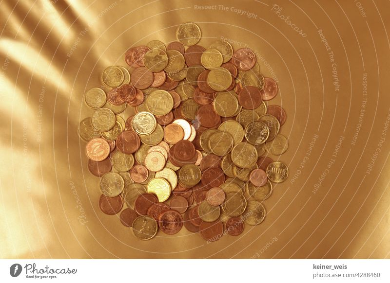 Many euro cent coins on a golden background - financial cushion from a pile of small change Money Cents Coin Euro Paying Financial Industry Economy finance Save
