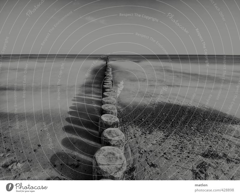 colourless Landscape Sand Water Sky Cloudless sky Horizon Weather Beautiful weather Waves Coast Beach Baltic Sea Black White groynes Shadow play Long exposure