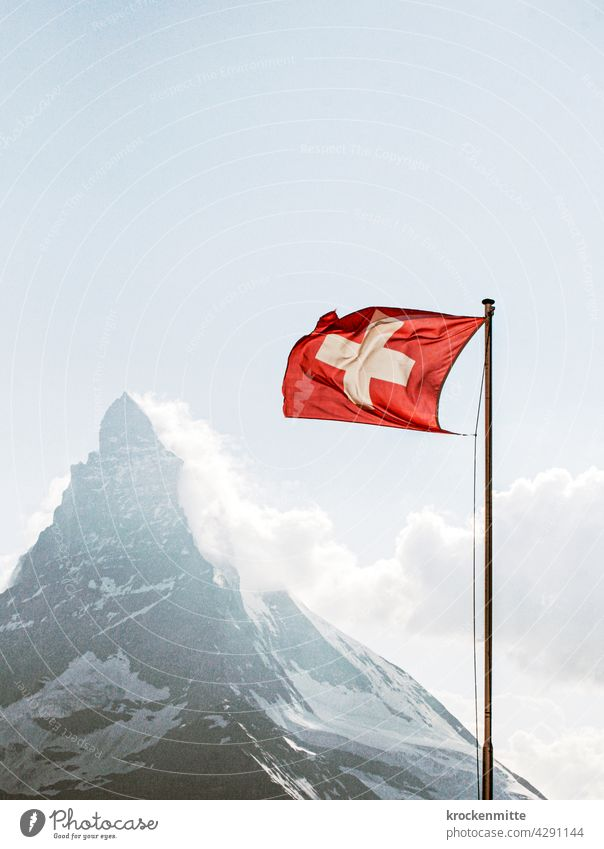 Swiss flag in the wind in front of Matterhorn Switzerland Flagpole Ensign Patriotism Blow Wind Sky Judder Pride Clouds Blue Exterior shot Red Zermatt Landmark