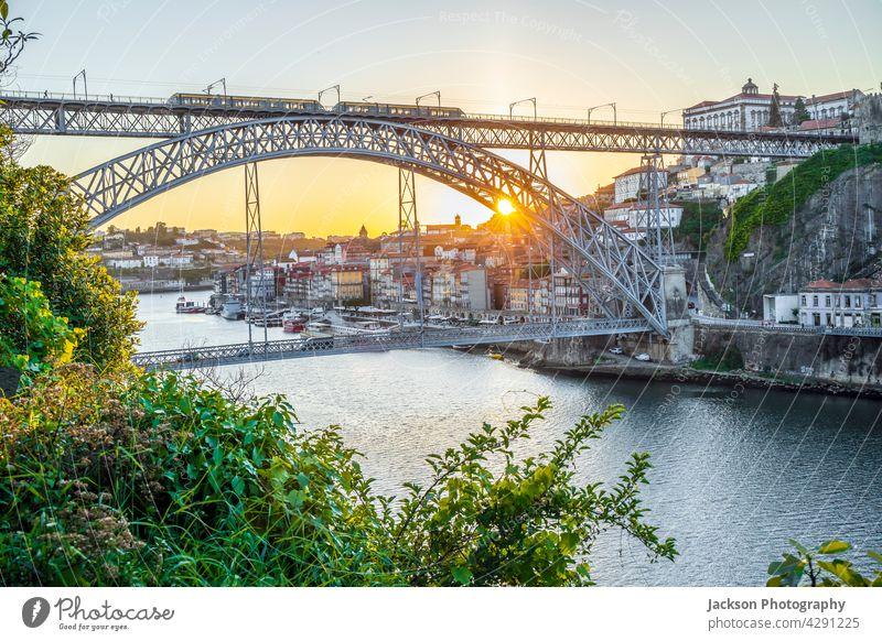 Cityscape of Porto with Douro river and famous bridge by sunset, Portugal porto portugal douro arch dom luis picturesque riverbank luis bridge outdoor