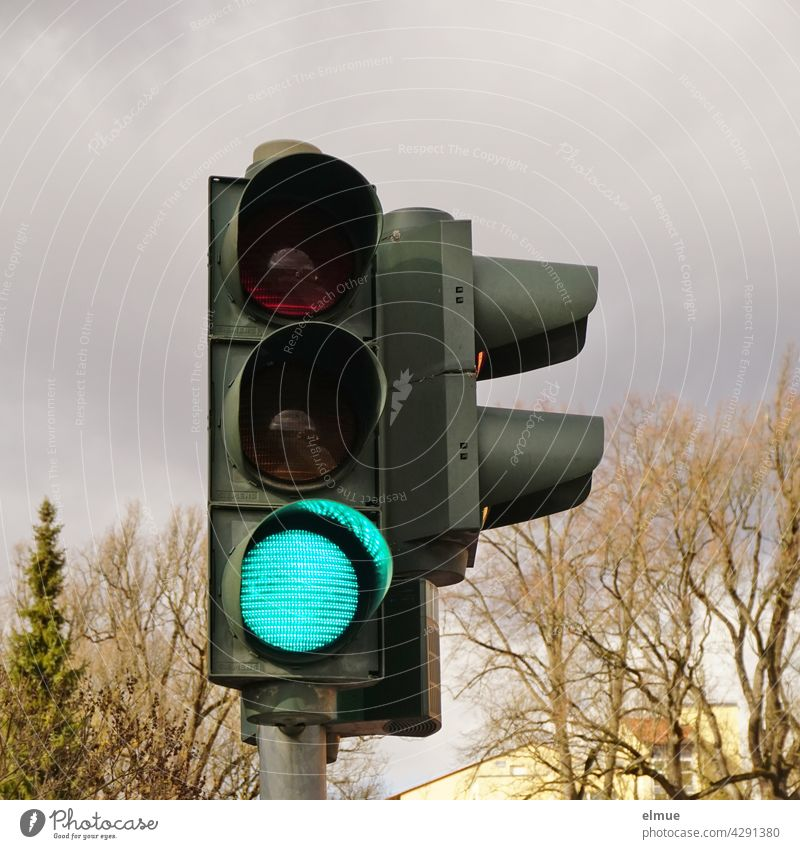 A traffic light at a pedestrian crossing is green for vehicles / light signal system / free passage Traffic light Road traffic Traffic lights Green free ride