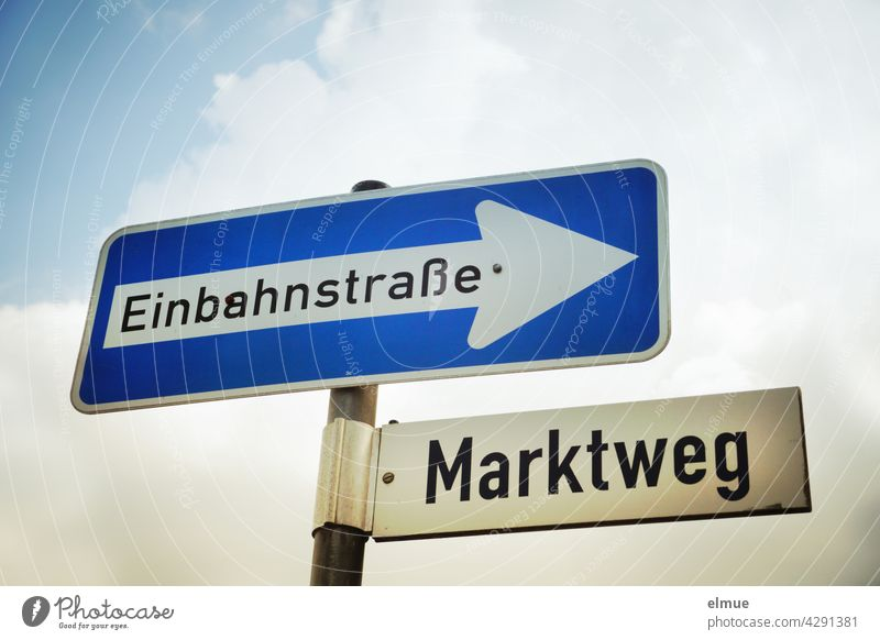 """Traffic sign """" One-way street """" and street sign """" Marktweg """" fixed at a metal bar / Orientation / VZ 220-20 Road sign prescribed direction Market Street"""