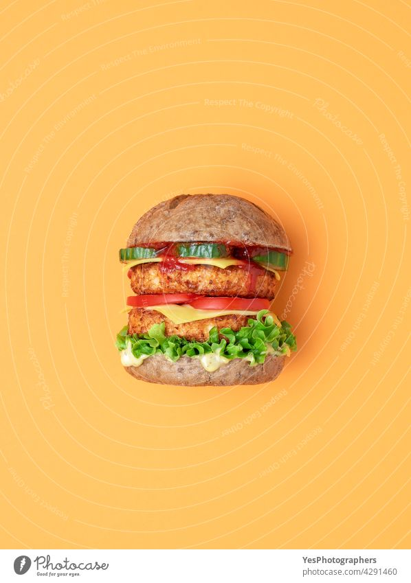 Veggie burger top view isolated on an orange background. above alternative bread bun cheese cheeseburger color consumerism cuisine cut out delicious dinner