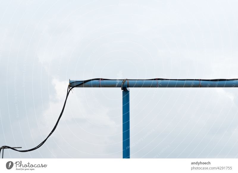 A blue water pipe on a construction site Background cable clean clear cloud connected connection copy space electric electrical electricity energy engineering