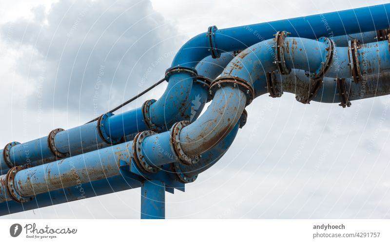 Composite of blue water pipes on a construction site Business cloud connection copy space drain drainage engineer engineering equipment fitting fix industrial