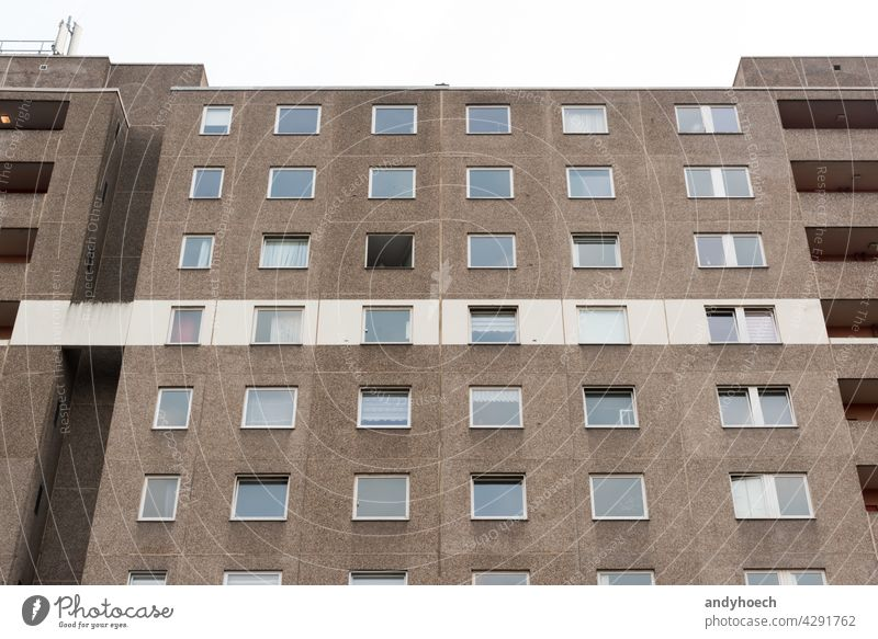 Cheap apartment in a gray high-rise building with a white stripe anonymity anonymously apartment search architecture block city concept