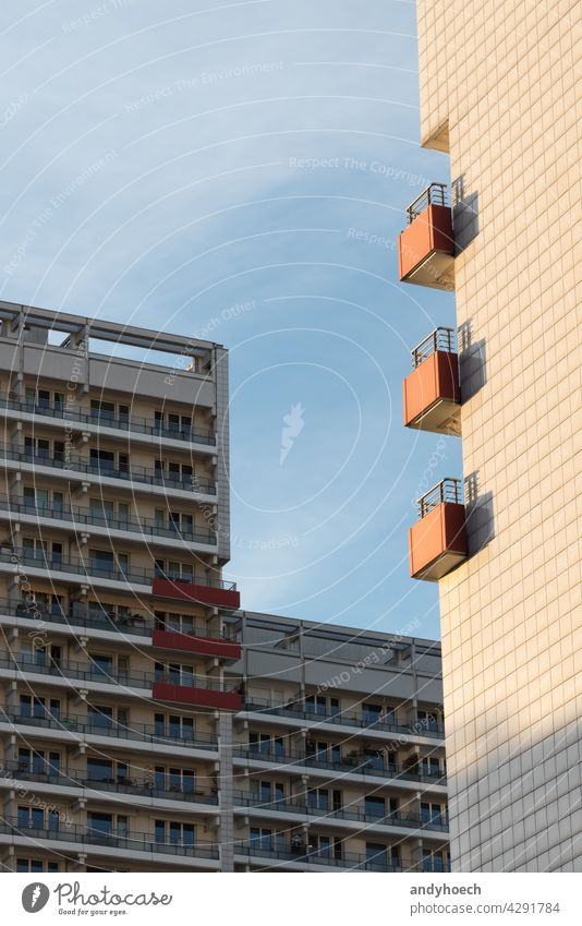 Three balconies on the sunny side of an apartment building anonymity apartments architecture bad luck balcony balcony home bliss block building exterior chance