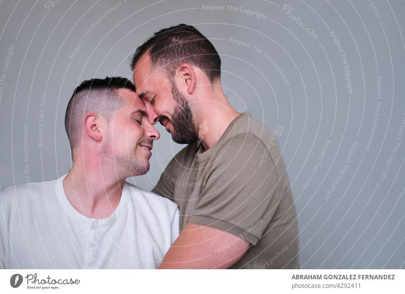 couple of smiling gay men embracing person man love homosexual cheerful togetherness lgbt adult pride relationship hug young gay couple lover romance boyfriend