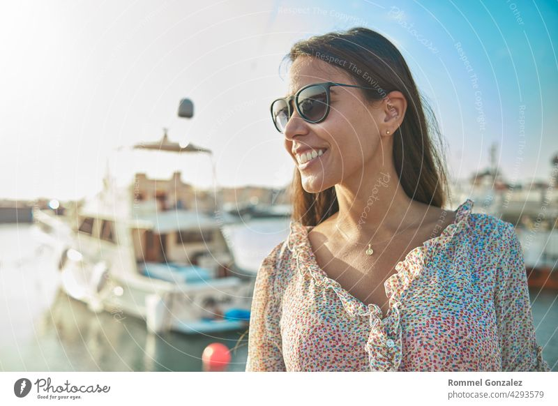 Beautiful young woman in luxury yacht bay, ready to sail. Summer concept. girl vacation summer beauty traveler pretty relax thinking model trip lifestyle