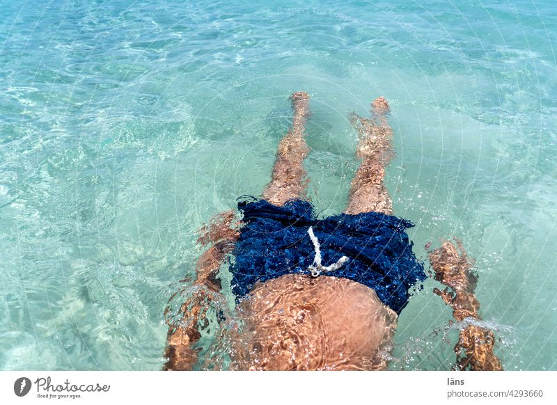 beach holiday vacation Vacation & Travel Ocean Man Human being Beach vacation drift Turquoise Swimming trunks Crete Swimming & Bathing Relaxation Blue